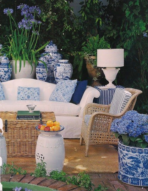 outdoor living with blue and white.   also <3 brick paver patio floor. via Slim Paley