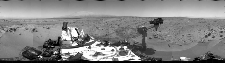 "This 360-degree scene shows the surroundings of the location where NASA's Mars rover Curiosity arrived on the 59th Martian day, of the rover's mission on Mars (Oct. 5, 2012).    Smooth surfaces of the windblown sand and dust of the ""Rocknest"" area, in the foreground, are what signaled from a distance that this might be an appropriate place to spend about three weeks collecting and using the mission's first few scoopfuls of soil. The rover scooped up its first sample on Oct. 7, 2012."