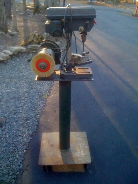 Drill Press Stand by hurricane -- Homemade drill press stand with the capacity to also mount a grinder. Constructed from steel plates and pipe, it incorporates locking casters to enhance mobility.  http://www.homemadetools.net/homemade-drill-press-stand-2