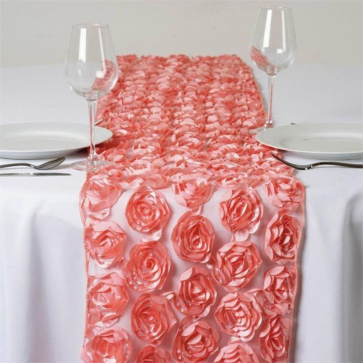 Wholesale Rose Quartz Lace Table Runner With Rosette Flowers Wedding Party Events | Few fabrics are designed by the master designers, simply with the intention to stand out and glam up the bearer, whether it's a hip celeb, or a truly posh party. This unique piece features absolutely voguish design of shimmery satin ribbons twirling and swirling into eye-catching flowers and coils atop a stunning see-through tulle. The glitzy sheen of satin ribbons coupled with glamorous sheer tulle makes…