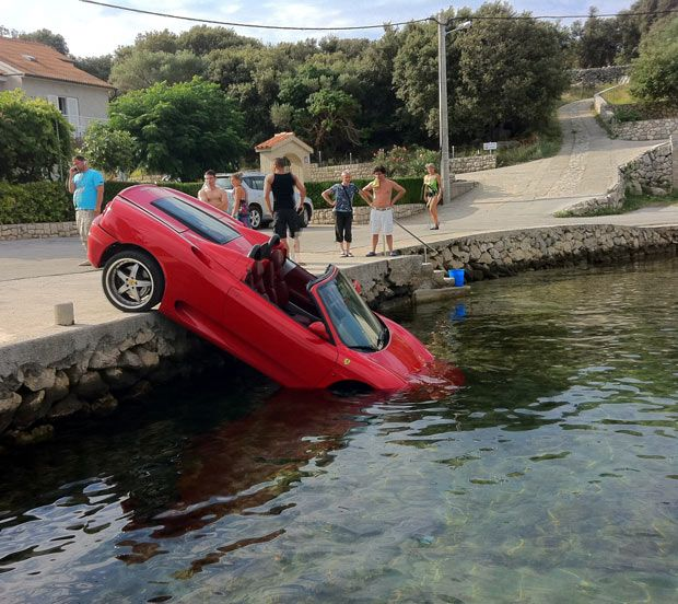 A Vanu0027s Brakes Failed, Barging A Ferrari Into The Sea. The Bright Red  Ferrari 360 Spider Was Parked At The Edge Of The Harbour While Its Owner  Was U2026