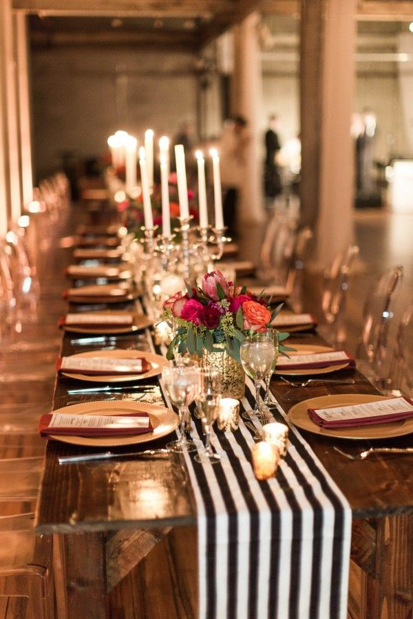 Fabulous black and white table runner + protea centerpieces + metallic gold candle holders | Lauren Fair Photography