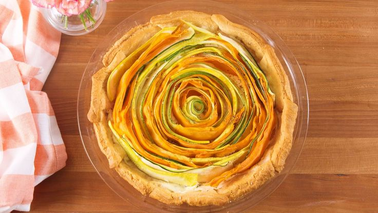 Bloomin' Vegetable Tart INGREDIENTS  1 tube refrigerated crescent rolls 8 oz. cream cheese, softened 1/2 c. freshly grated Parmesan 1 tsp. lemon juice 1 tsp. chopped fresh thyme 1 tbsp. chopped fresh parsley kosher salt Freshly ground black pepper 1 large zucchini 1 large yellow squash 1 large carrot, peeled 1 tbsp. extra-virgin olive oil