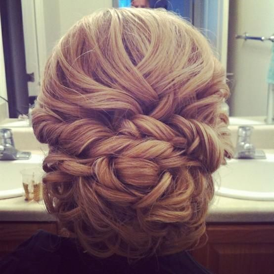 low curly bun with wrap around pieces and criss-cross top- best with high and low light hair