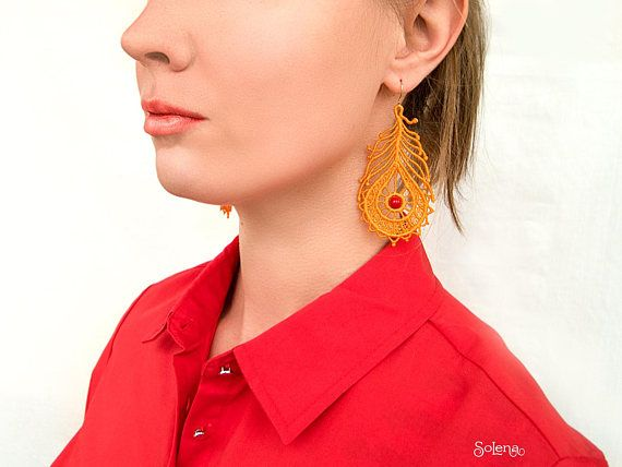 #Orange #earrings #plumage with a #red bead #Rowan . Elegant and #bright sun - #colored #feathers #earrings . #Romantic jewelry for #feminine and #creative #girls. Any #woman will be #happy with these #city #Style #jewellery.  Sunshiny lacy earrings size: 2.95 inch (7.5 cm) 1.57 inch (4 cm) without the hook. Hypoallergenic ear wire. Do not contain lead and nickel, coated with 925 silver.   If you want, we can make our jewelry in a #different color. Do not hesitate to ask questions, we are…
