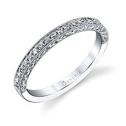 Create a romantic wedding set with this milgrain accented band with channeled round brilliant diamonds and pair it with its matching engagement ring with the identical detailed accents.