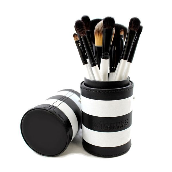 Flawlessly apply make up with this 12-piece brushes set to create glamorous high-fashion looks. Perfect for traveling, these brushes come with a black and white striped carrying case. Set includes: Po