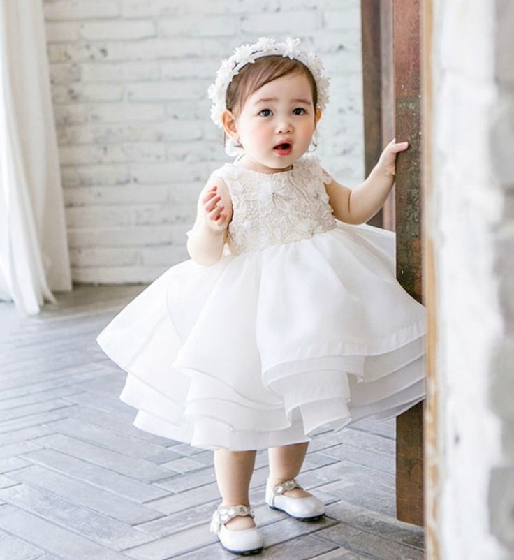 Flower Embroidery Tiered Dress--Made To Order - High Quality Beautiful Round Neckline Sleeveless Knee Length Tiered Layered Little & Big Girl Embroidered Floral Party Dress. Perfect dress for birthday party, wedding, baptism, photo shoot or any special occasion. Available from 1 - 12 years. Material: Cotton, soft polyester fabric, satin Color: White. Please do compare your  little girl measurements with our size chart below or you may leave a note your little girl's measurements.