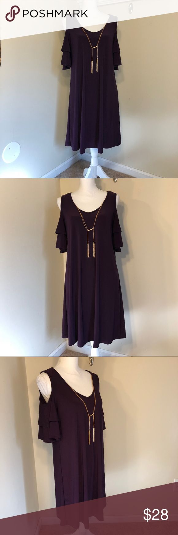 Luxology NWT Could Shoulder Swing Dress Purple, grape hued, a-line, loose fitting, cold shoulder, layered sleeve, midi/mini swing dress. Dress features a built in detachable gold toned necklace. NWT No rips, stains or pulls. Measurements are 35.5 inches from shoulder to hem, 17.5 inches across the chest, 18 inches across the waist, and an 11.5 inch sleeve (Sleeve length is approximate) (Item GHM017) Luxology Dresses