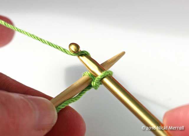Crochet cast-on: Pass the crochet hook over the knitting needle again