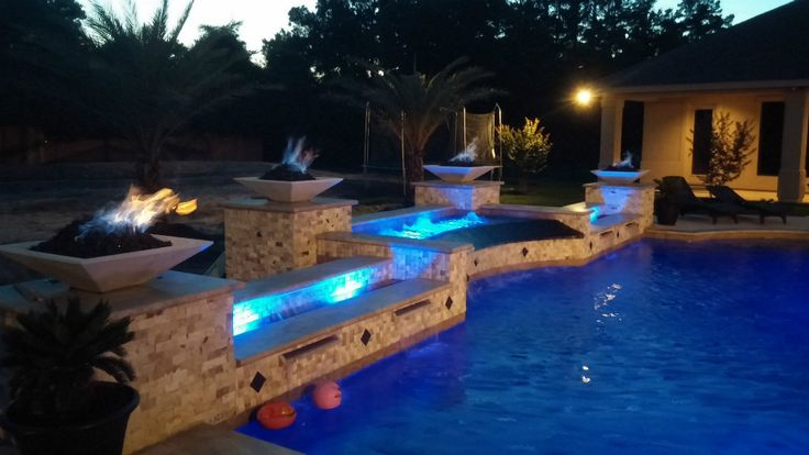 Custom pool with infinity edge spa 4 fire bowls and for Custom swimming pool designs