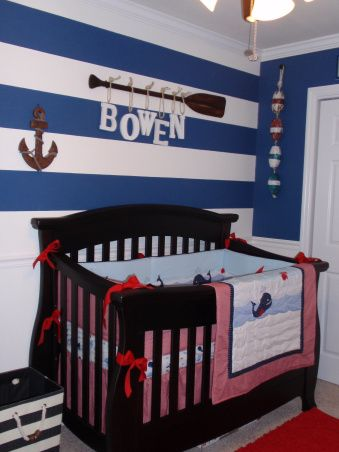 Nautical Nursery with wainscoting and striped wall. I love the bobbers hanging in a row and the dark colored anchor!