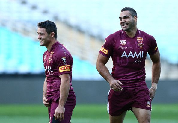(L-R) Cooper Cronk and Greg Inglis smile during a Queensland Maroons state of origin training session at ANZ Stadium on June 4, 2013 in Sydney, Australia.