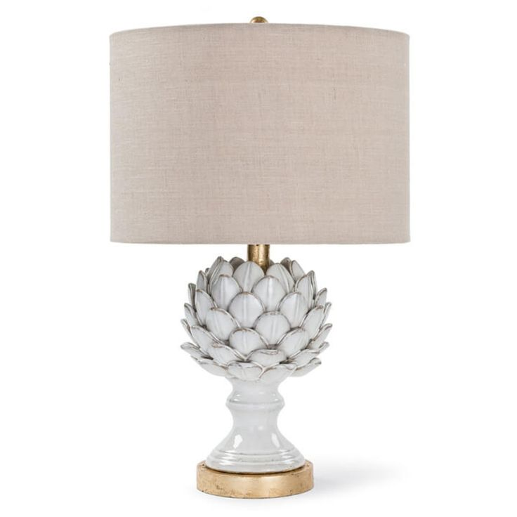 "Who knew that artichokes could be chic? This lovely table lamp features gold accents and is topped with a beige circular shade. It measures 20.5"" H x 13"" W x 13"" D. It takes a 3-way 100 watt maximum bulb (not included). Shipping within the continental U.S. is $24. Click on image for greater detail."