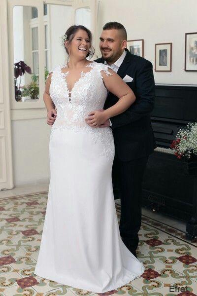Plus size lace corset mermaid wedding dress with a deep V neckline
