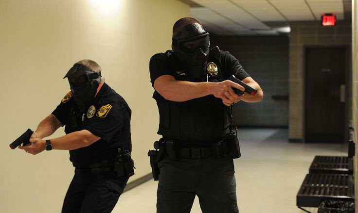 Officers from various Story County law enforcement agencies, check hallways during violent assailant training at Iowa State University's Ross Hall Wednesday, August 9, 2017, in Ames, Iowa. Photo by Nirmalendu Majumdar/Ames Tribune http://www.amestrib.com/news/20170809/isu-police-simulate-violent-incident-0010on-campus-with-story-county-agencies