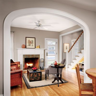 """Convert a square or rectangular opening into an archway to call more attention to what lies behind. """"An arch is a powerful design element because it has a pronounced center that turns whatever it frames into a focal point,"""" says Davis."""