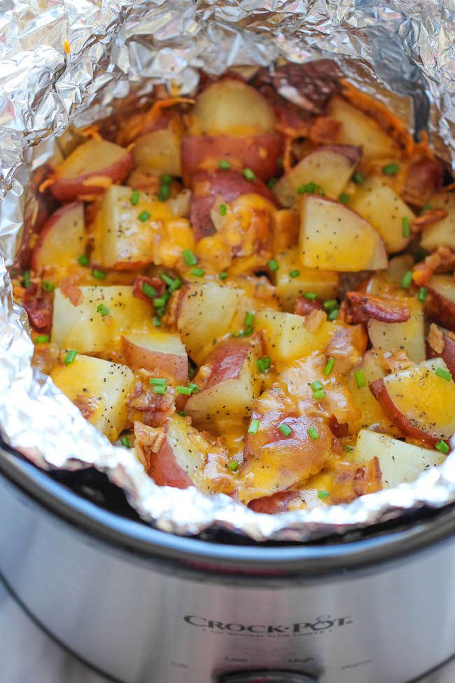 Slow Cooker Cheesy Bacon Ranch Potatoes - The easiest potatoes you can make right in the crockpot - perfectly tender flavorful and cheesy!