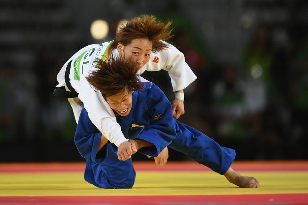 Ami Kondo of Japan (blue) takes down Urantsetseg Munkhbat of Mongolia during the women's 48kg Bronze Medal A judo contest on Day 1 of the Rio 2016 Olympic Games at Carioca Arena 2 on Aug. 6, 2016, in Rio de Janeiro. | Best Photos From The Rio Olympics