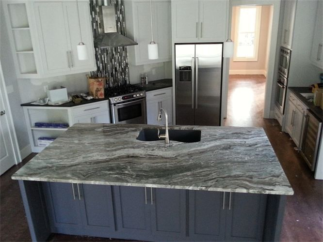 Fantasy Brown Quartz this kitchen has the same counter