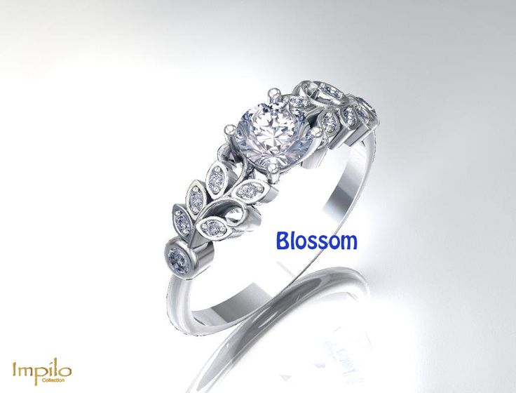 """""""Blossom"""" - This stunning engagement ring has one round brilliant cut diamond centre stone with six diamonds on each side in the leaf pattern."""