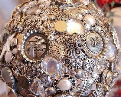 Take an old silver (in this case) plastic Christmas ball and cover w/silver buttons (cut hasp off back), filling in odd spots w/clear half-marbles and beads and have a beautiful orb to sit...wherever.