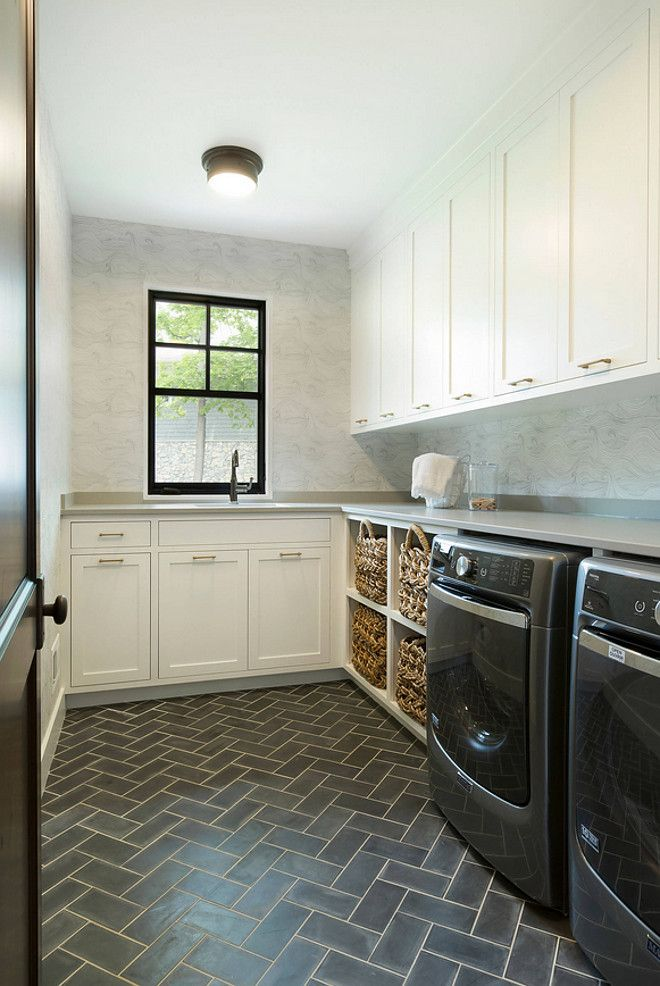 Custom handmade cement floor tiles laid in a herringbone pattern. Laundry room…
