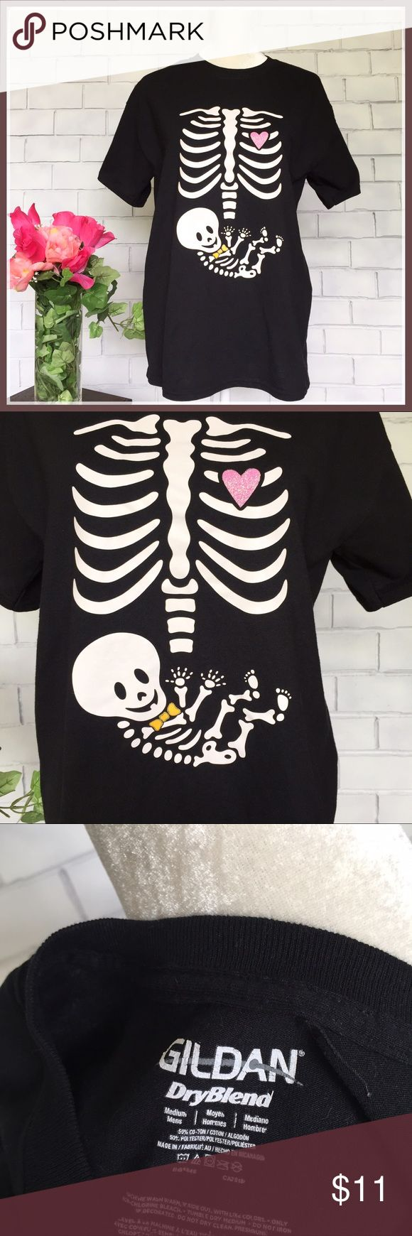 Maternity Skeleton X-Ray Funny Cute T-Shirt Top Adorable maternity top with a little sense of humor. X-ray skeletal front with orange little bow tie and glittered pink heart. Size medium in excellent condition. %50 cotton and 50%polyester material. Please note the label states medium men's but is indeed a women's maternity size medium. Thanks so much for looking! Gildan Tops Tees - Short Sleeve