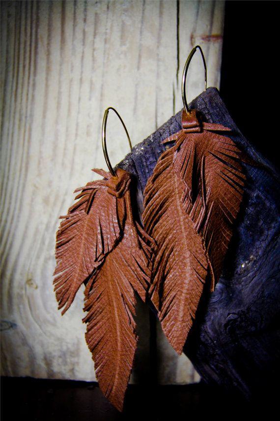 Realizar plumas u otros objetos a partir de cartulinas.
