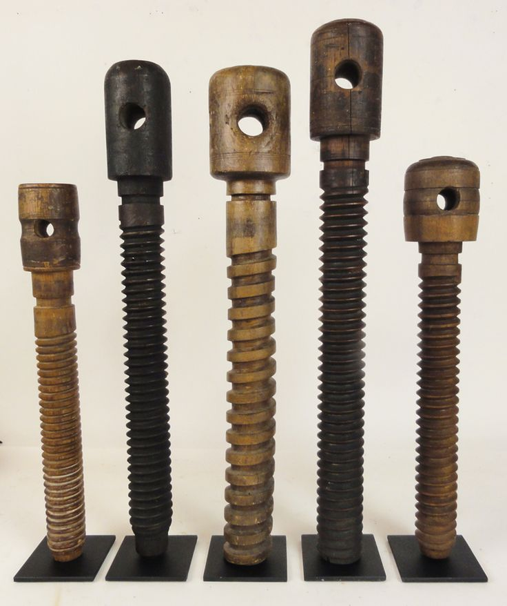 antique wooden vise screws from woodworkers and carpenters work tables.