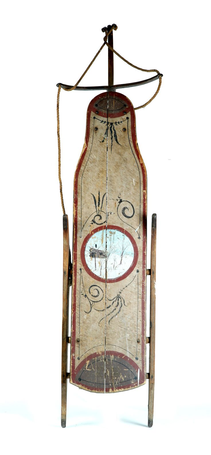 """Garths   Full Details for Lot 474   DECORATED SLED. Attributed to Maine, late 19th-early 20th century, pine and iron. Ex Pam Boynton (Massachusetts). Pivoting runners and original decoration, including a central winter landscape. 68""""l. Estimate $ 300-600"""