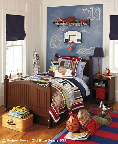 Inspiration for Landon's pottery barn kids varsity room. The roller shade in the window and baseball lamp is a great idea to add to his room.