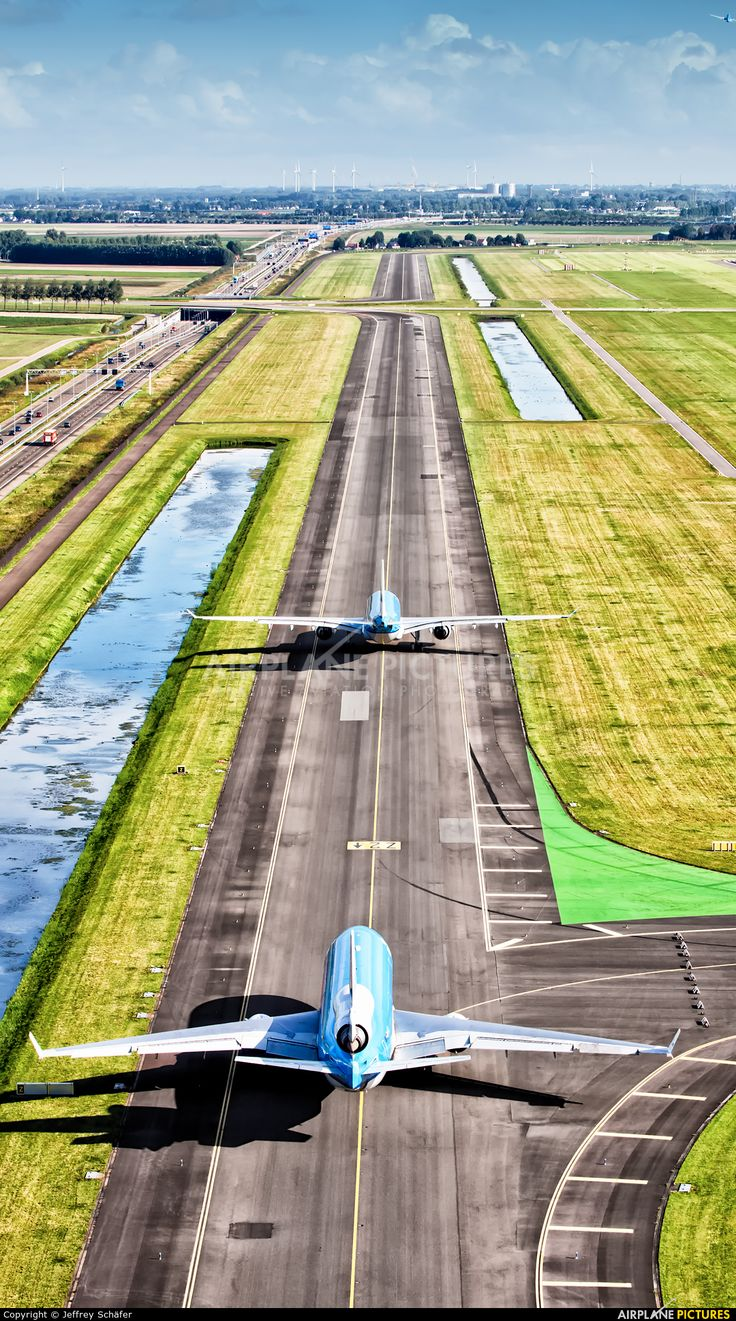 Two KLM Ships on their way to runway 36L through the Dutch landscape.