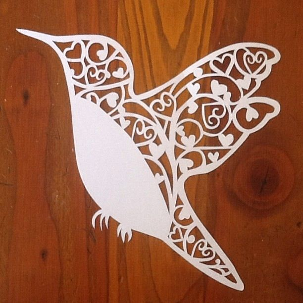 Handcut paper bird design.  Orders taken, email nmhealy@hotmail.com