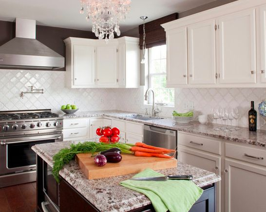 Most of the clients we work with are trying to bring their late 1990's- early 200o's Tuscan kitchen into the white/gray/cream updated kitchen of the moment. Many of them are also looking to update their backsplash, but keep the granite. One of my favorite color experts, Maria Kilim has coined the phrase,