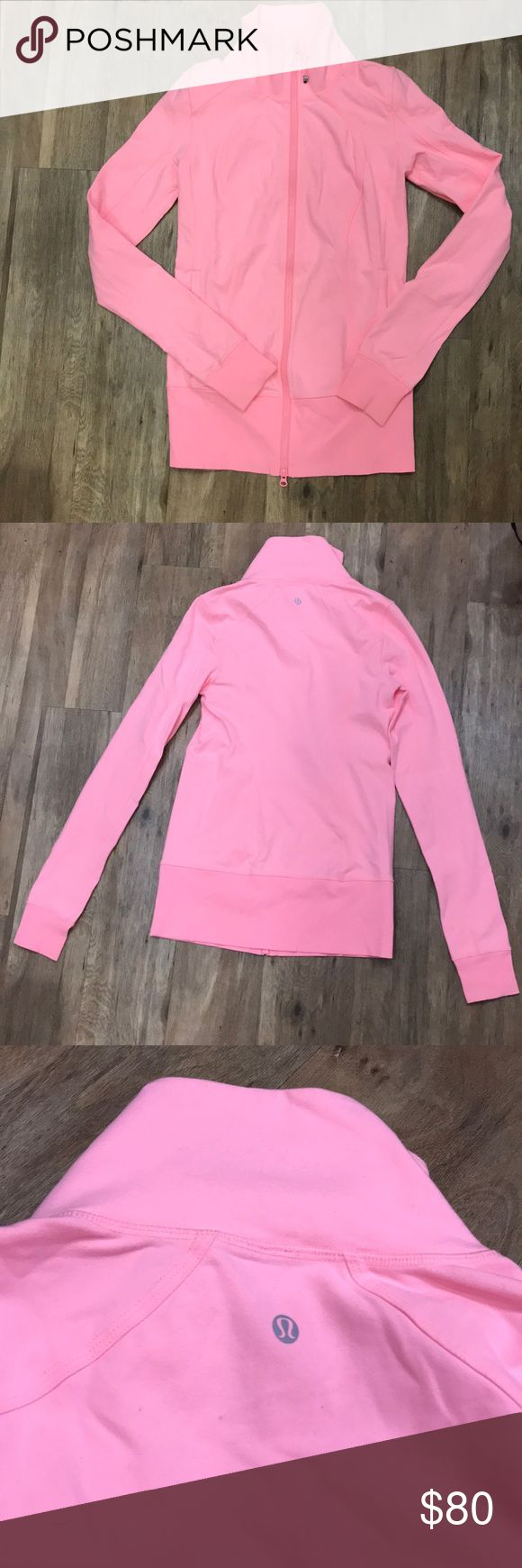 Lululemon Coral Pink High Neck Running Jacket High-neck, no-hood Lululemon running jacket. Similar to the Define jacket, but less form-fitting. Size 6 (Small). Bright coral pink color. Fit is a little longer than hips. Includes thumb holes, Lululemon logo zipper pull, and reflective logo on back of neck. Amazing condition and very well-cared for. lululemon athletica Tops Sweatshirts & Hoodies
