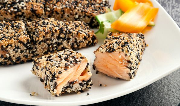 Sesame-Crusted Salmon with a Ginger Lime Vinaigrette - salmon fillets coated in sesame seeds and wasabi paste are drizzled with ginger lime vinaigrette and grilled to perfection, creating a delicious Asian-inspired dish that's healthy and delicious.