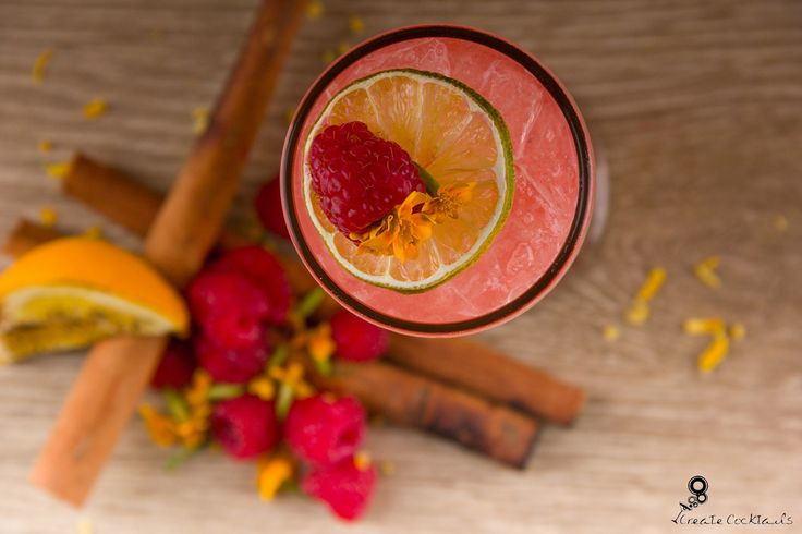 Mexican Wave: Tequila shaken with fresh raspberry, spiced sugar, lime and orange bitters, topped with orange blossom soda