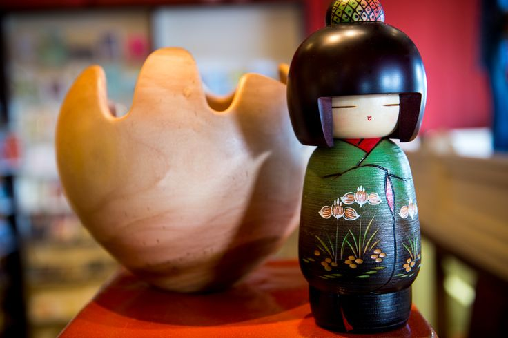 Kokeshi doll and hand carved wooden bowl.
