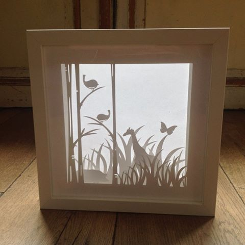 Shadow Box. Silhouette Cameo. Papercraft. Work my M Papaopoulou:  Ribba frame Ikea 23x23. Silhouette: Birds on trees #72805 , Border Grass #24501. Welded butterfly to the back panel the grass. Animals individually cut folded at feet. Weld  square of card to them to adhere glue and then add to inside of the frame. Grass panel cut twice - one without the butterfly and flipped the image and cut again. One panel adhered to the front then the Ribba insert, then the second frame and last the…