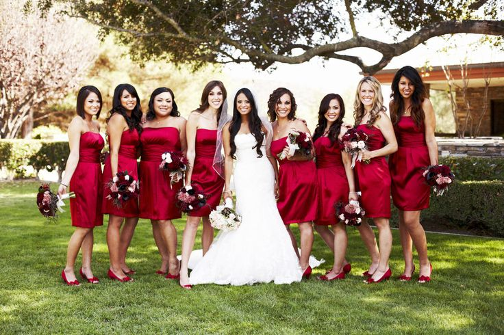 A radiant bridal party in cranberry red! | Photo by Josh Elliott