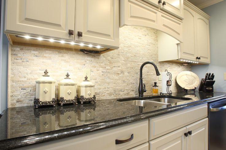 travertine backsplash Kitchen Traditional with GE Slate brass kitchen hardware