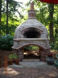 outside brick oven perfect for making mozzarella and spinach pizzas, yummy!