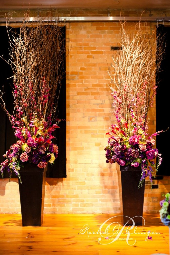 Ceremony urns that combine branches and florals. We like the look and the shape of these, except the flowers would need to change to match your wedding colours (we suggest whites, yellows and light blues)