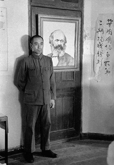 Zhou Enlai standing in front of a picture of Karl Marx at the headquarters of the Hankou Central Committee of the Chinese Communist Party, China], ca. July 1938 ? Robert Capa/Magnum Photos/ICP