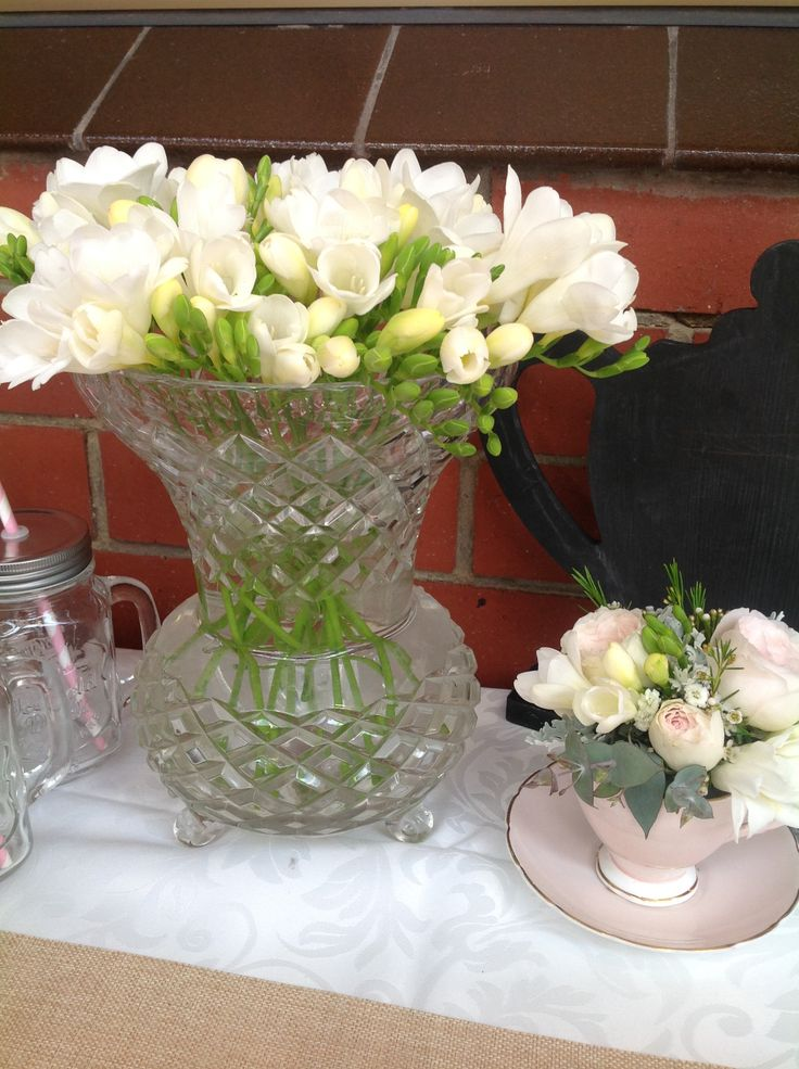 vintage cut glass vase with fresh fressias www.houseofthebride.com.au