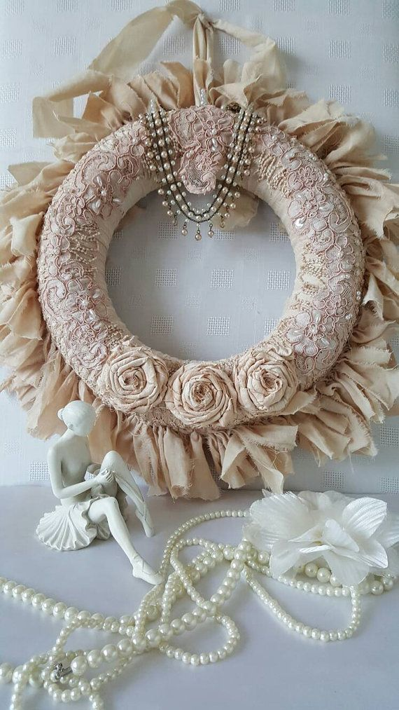 Check out this item in my Etsy shop https://www.etsy.com/uk/listing/261381967/vintage-cream-fabric-and-lace-wreath