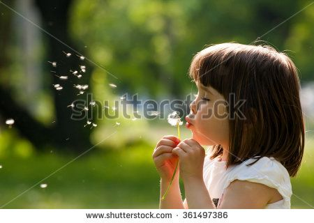 Beautiful child with dandelion flower in spring park. Happy kid having fun outdoors. - stock photo