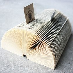 Make your own business card holder from an old book! This looks great, is practical and will take you no more than 15 minutes.