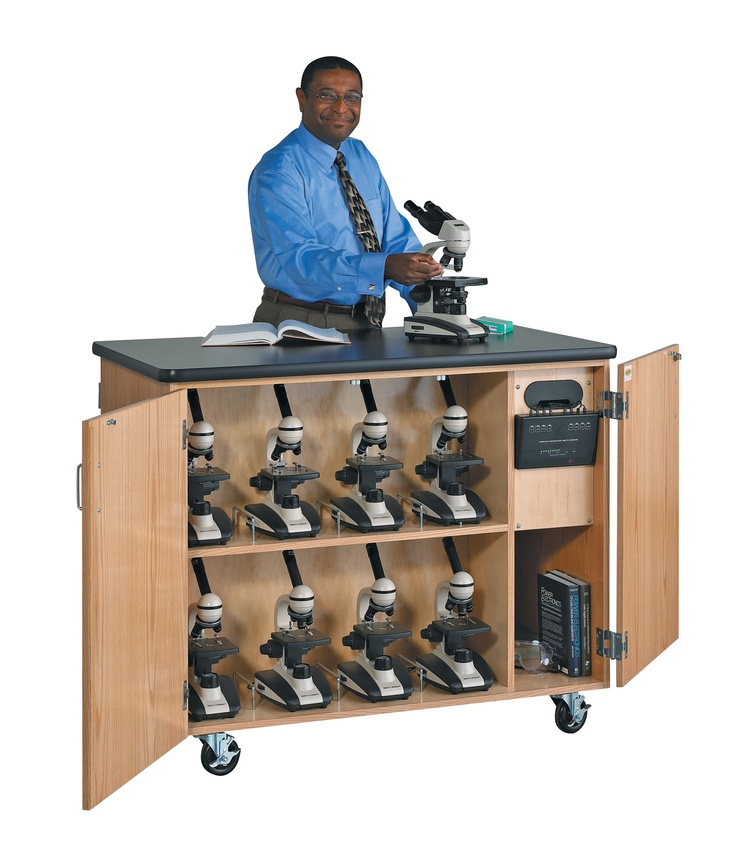 Mobile Micro-Charge Station - This cabinet is equipped to recharge any Ken-A-Vision cordless microscope within eight hours while it is safely stored behind locked doors. The peninsula style cabinet holds 16 microscopes (eight each side) and has storage space for other essentials such as slides. The LED meter lets you know when the microscopes are charging and when they are fully charges. All this with only one electrical connection. (DW_4741K)